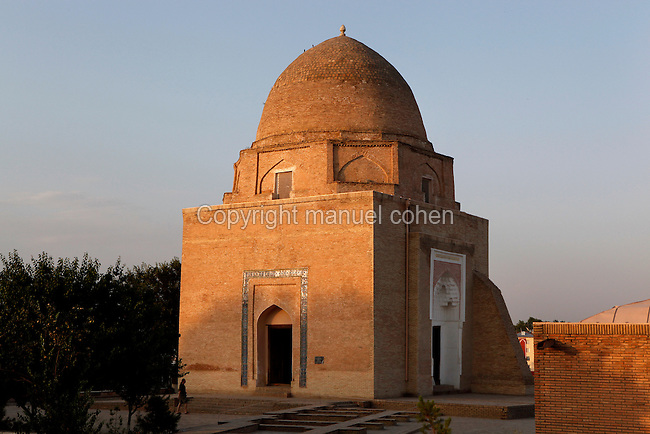 General view of Rukhabad Mausoleum, 14th century, Samarkand, Uzbekistan, pictured on July 14, 2010, at sunset. The Rukhabad Mausoleum (Abode of the Spirit) was built by Timur over the grave of the mystic Sheikh Burhan al-Din Sagarji. The cubic building is topped with a dome based on an octahedron and mausoleum has three entrances. The simple interior walls are covered with alabaster plasterwork with one glazed tile band. A  19th century carved wooden door leads to the tomb. Samarkand, a city on the Silk Road, founded as Afrosiab in the 7th century BC, is a meeting point for the world's cultures. Its most important development was in the Timurid period, 14th to 15th centuries. Picture by Manuel Cohen.
