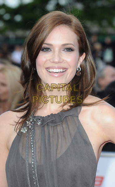MANDY MOORE .Attending the National Movie Awards 2011 at Wembley Arena, London, England, UK, May 11th 2011..portrait headshot sheer ruffle smiling grey gray .CAP/WIZ.© Wizard/Capital Pictures.