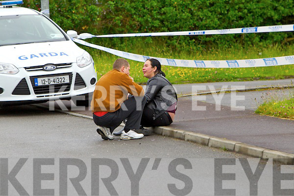 Deceased womans sister Kristina and her husband Viadas at the scene of the Double murder at Langford Downs Killorglin on Monday Morning