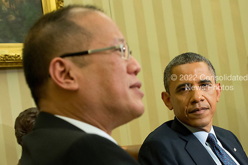 United States President Barack Obama meets with President Benigno Aquino of the Philippines in the Oval Office at the White House in Washington, DC on Friday, June 8, 2012.  .Credit: Kevin Dietsch / Pool via CNP
