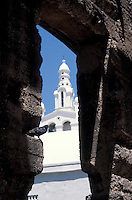 Church steeple framed by ruins in old Santo Domingo, Dominican republic. Santo Domingo's Zona Colonial was declared a UNESCO World heritage Site in 1990.
