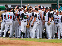 GREEN BAY - June 2015: Green Bay Bullfrogs players during a Northwoods League game against the Kenosha Kingfish on June 21st, 2015 at Joannes Park in Green Bay, Wisconsin. Green Bay defeated Kenosha 10-7. (Brad Krause/Krause Sports Photography)