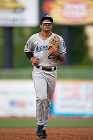 West Michigan Whitecaps center fielder Derek Hill (23) jogs back to the dugout during the first game of a doubleheader against the Lake County Captains on August 6, 2017 at Classic Park in Eastlake, Ohio.  Lake County defeated West Michigan 4-0.  (Mike Janes/Four Seam Images)
