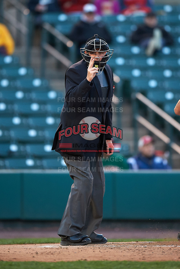 Umpire Chad Whitson makes a call during a game between the Toledo Mudhens and Rochester Red Wings on May 12, 2015 at Frontier Field in Rochester, New York.  Toledo defeated Rochester 8-0.  (Mike Janes/Four Seam Images)