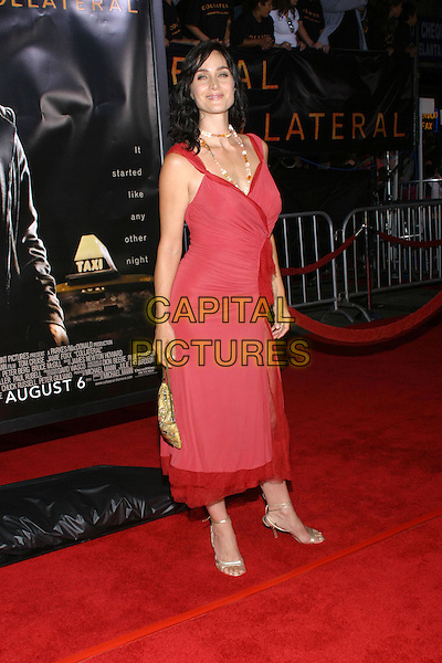 CARRIE ANN MOSS.At the Collateral Premiere, held at the Orpheum Theatre, Los Angeles, CA, USA,.2nd August 2001.full length red dress gold bad beads.**UK SALES ONLY**.Ref:JW-ADM.www.capitalpictures.com.sales@capitalpictures.com.©Capital Pictures.