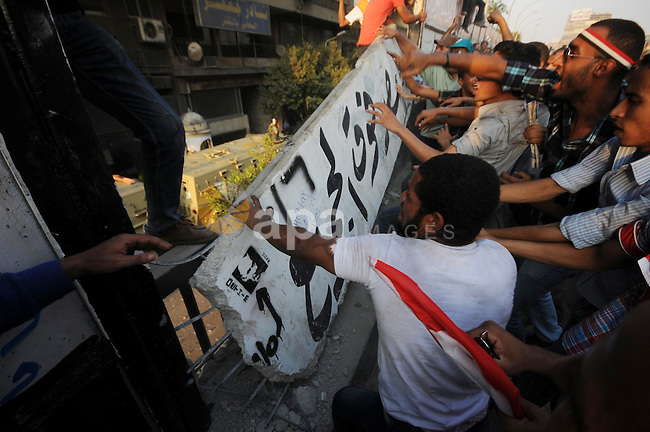 Egyptian protesters dismantle the concrete wall which was built in front of the Israeli embassy, in Cairo, Egypt, 09 September 2011. Security forces had built the wall in an attempt to secure the embassy after a series of protests were held in front of the building. The protesters were angered over the killing of five Egyptian policemen on the border with Israel. Photo by Ahmed Asad