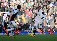 Pictured: Jonathan de Guzman of Swansea (R). 01 February 2014<br /> Re: Barclay's Premier League, West Ham United v Swansea City FC at Boleyn Ground, London.