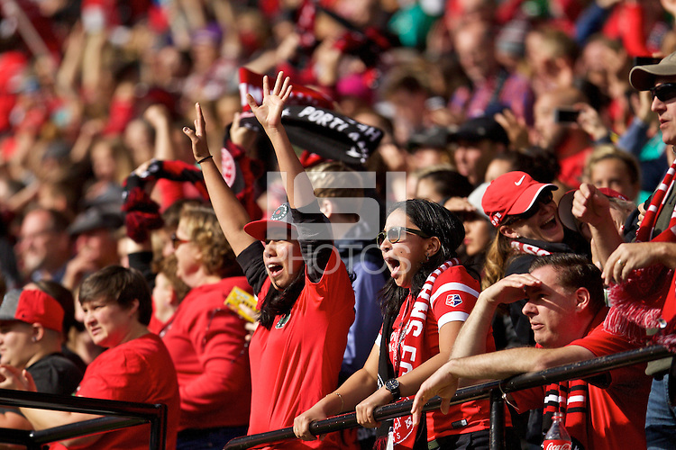 Portland, Oregon - Sunday October 2, 2016: Thorns supporters cheer during a semi final match of the National Women's Soccer League (NWSL) at Providence Park.