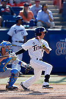 Richy Pedroza #6 of the Cal State Fullerton Titans bats in front of Shane Zeile #14 of the UCLA Bruins during the NCAA Super Regional at Goodwin Field on June 7, 2013 in Fullerton, California. UCLA defeated Cal State Fullerton, 5-3. (Larry Goren/Four Seam Images)