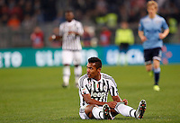 Calcio, Serie A: Lazio vs Juventus. Roma, stadio Olimpico, 4 dicembre 2015.<br /> Juventus&rsquo; Alex Sandro sits on the pitch during the Italian Serie A football match between Lazio and Juventus at Rome's Olympic stadium, 4 December 2015.<br /> UPDATE IMAGES PRESS/Riccardo De Luca