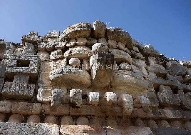 The Great Palace, detail of a mask of Chaac, big-nosed god of the rain, Symbol of the corn (¤) above the two eyes, Puuc Style, 750 ? 1000 AD, Sayil, Yucatan, Mexico. Picture by Manuel Cohen
