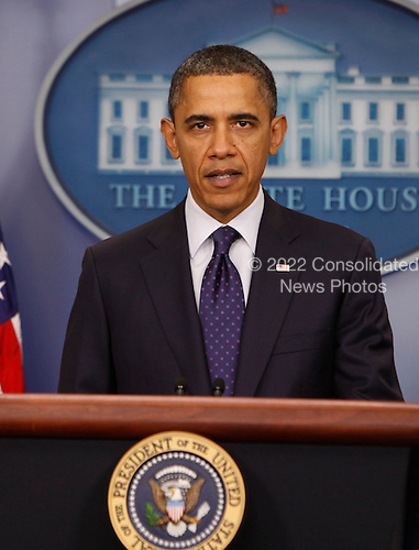 "United States President Barack Obama makes a statement in the Brady Press Briefing Room after signing H.R. 3765  ""Temporary Payroll Tax Cut Continuation Act of 2011"" in the Oval Office on Friday, December 23, 2011. .Credit: Dennis Brack / Pool via CNP"