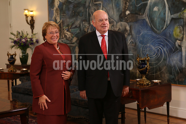 President of Chile Michelle Bachelet receives at La Moneda Presidential Palace OAS cretary General Miguel Angel Insulza, during her first day in office in Santiago, Chile