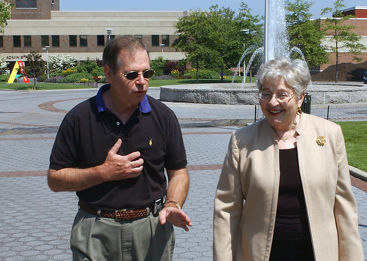 SUNY Stony Brook Communications Director, Patrick Calabria with University President Shirley Strum Kenny on the Stony Brook Campus on Tuesday June 21, 2005. (Newsday Photo / Jim Peppler).