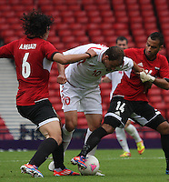Men's Olympic Football match Egypt v Belarus on 1.8.12...Renan Bardini Bressan of Belarus and Ahmed Hegazi (left) and Hassan Hossam of Egypt, during the Men's Olympic Football match between Egypt v Belarus at Hampden Park, Glasgow.