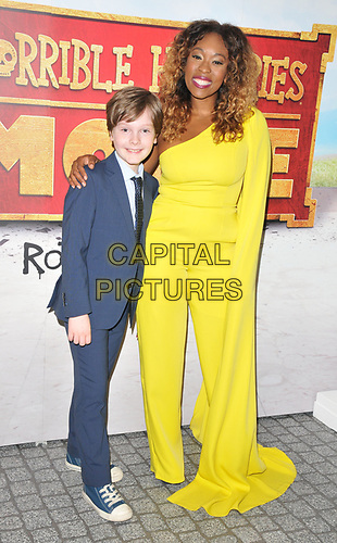 """Hector Bateman-Harden and Dominique Moore at the """"Horrible Histories: The Movie - Rotten Romans"""" world film premiere, Odeon Luxe Leicester Square, Leicester Square, London, England, UK, on Sunday 07th July 2019.<br /> CAP/CAN<br /> ©CAN/Capital Pictures"""