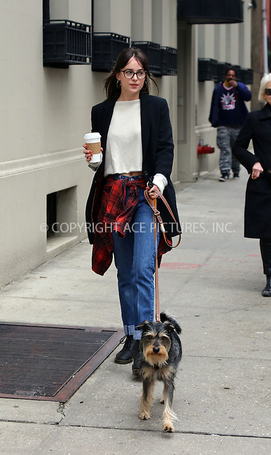 WWW.ACEPIXS.COM<br /> <br /> April 10 2015, New York City<br /> <br /> Actress Dakota Johnson takes her dog Zeppelin out for a walk in Greenwich Village on April 10 2015 in New York City<br /> <br /> By Line: Philip Vaughan/ACE Pictures<br /> <br /> ACE Pictures, Inc.<br /> tel: 646 769 0430<br /> Email: info@acepixs.com<br /> www.acepixs.com