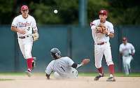 STANFORD, CA - March 27, 2011: Kenny Diekroeger and Lonnie Kauppila of Stanford baseball turn the double play during Stanford's game against Long Beach State at Sunken Diamond. Stanford won 6-5.