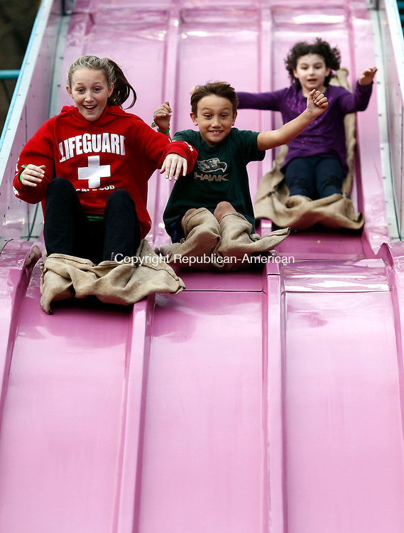 Barkhamsted, CT- 11 October 2013-101113CM03-  Left to right, Jana Sanden, 10, Justin Sanden, 7 and Jolie St. Hilaire, 7, all of Barkhamsted enjoy a ride down the giant slide during the opening night of the annual Riverton Fair Friday night.  The giant slide is one of the many rides and attractions that will be at the fair this weekend.  The fair continues Saturday from 8:00 AM until 9:00 P.M. Sunday 8:00 AM until 5:00 P.M.   Christopher Massa Republican-American