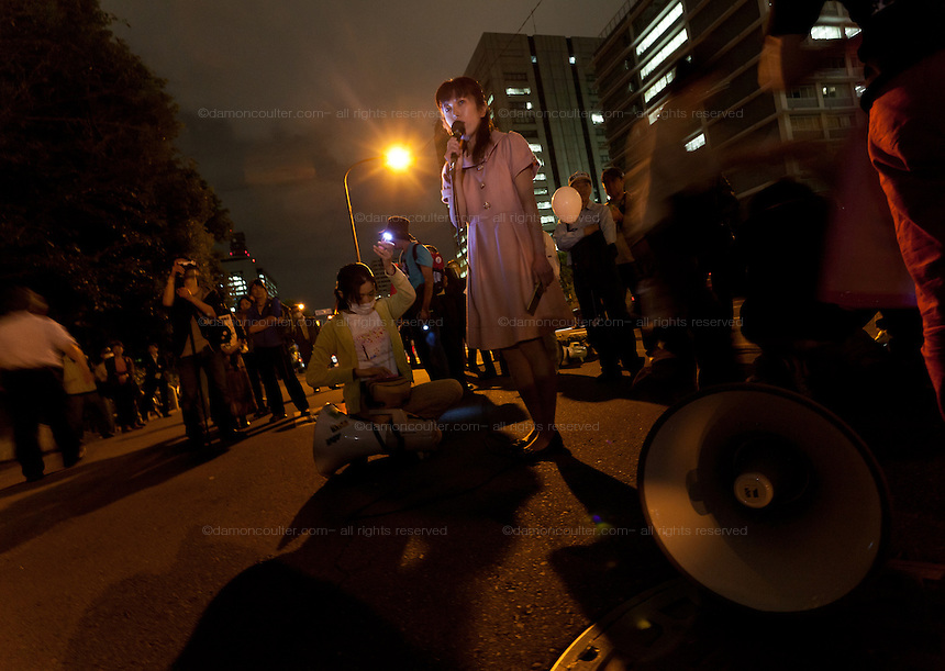 An anti Nuclear protestor speakes at the Friday night protests around the parliament building in Nagatacho, Tokyo, Japan Friday October 12th 2012