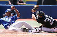 May 25th 2008:  Outfielder Jose Guillen (11) of the Kansas City Royals is tagged out by Toronto Blue Jays catcher Rod Barajas (20) during a game at the Rogers Centre in Toronto, Ontario, Canada .  Photo by:  Mike Janes/Four Seam Images