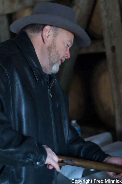 Fred Noe, master distiller for Jim Beam and the great grandson of the Jim Beam, extracts Knob Creek from a barrel aging the popular bourbon.  Knob Creek is a part of the Jim Beam family of bourbons produced in Claremont, Ky.
