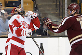 Matt Lane (BU - 21), Michael Matheson (BC - 5) - The Boston College Eagles defeated the Boston University Terriers 3-1 (EN) in their opening round game of the 2014 Beanpot on Monday, February 3, 2014, at TD Garden in Boston, Massachusetts.