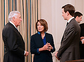 United States House Minority Whip Steny Hoyer (Democrat of Maryland), left, and US House Minority Leader Nancy Pelosi (Democrat of California), center, speak with Jared Kushner, Senior Advisor to the President, right, prior to the arrival of US President Donald Trump at a reception for US House and US Senate Republican and Democratic leaders in the State Dining Room of the White House in Washington, DC on Monday, January 23, 2017.<br /> Credit: Ron Sachs / Pool via CNP