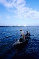 Fishermen in traditional Vietnamese conical hats on Thu Bon River, Hoi An, Vietnam