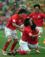 Korea Republic players celebrate after their goal. Korea Republic defeated Togo 2-1 in their FIFA World Cup Group G match at the FIFA World Cup Stadium, Frankfurt, Germany, June 13, 2006.