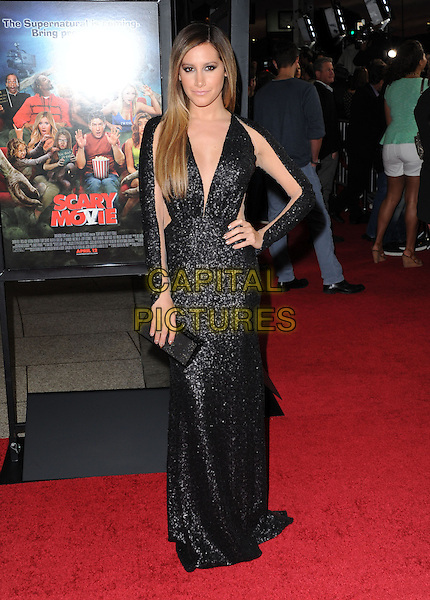 Ashley Tisdale.at The Dimension Films Premiere of 'Scary Movie 5' held at The Cinerama Dome in Hollywood, California, USA, April 11th 2013.                                                               .full length dress sleeves cut out sheer see thru through black sequined sequin low cut ombre hair dyed clutch bag sleeves long maxi hand on hip .CAP/DVS.©Debbie VanStory/Capital Pictures