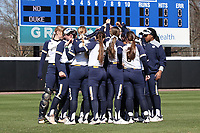 DURHAM, NC - FEBRUARY 29: Notre Dame University softball players huddle during a game between Notre Dame and Duke at Duke Softball Stadium on February 29, 2020 in Durham, North Carolina.