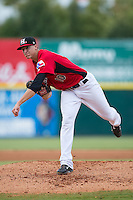 Hickory Crawdads pitcher Brett Martin (10) follows through on his delivery against the West Virginia Power at L.P. Frans Stadium on August 15, 2015 in Hickory, North Carolina.  The Power defeated the Crawdads 9-0.  (Brian Westerholt/Four Seam Images)