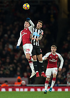 GranitXhaka of Arsenal battles with Joselu of Newcastle United during the Premier League match between Arsenal and Newcastle United at the Emirates Stadium, London, England on 16 December 2017. Photo by Vince  Mignott / PRiME Media Images.