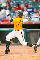 Max Muncy #9 of the Baylor Bears follows through on his swing against the Rice Owls at Minute Maid Park on March 6, 2011 in Houston, Texas.  Photo by Brian Westerholt / Four Seam Images