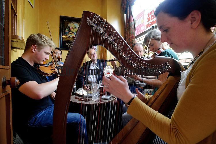 A session gets going in Fawl's Bar snug in Ennis during Fleadh Cheoil na hEireann. Photograph by John Kelly.