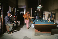 December 1976. Americus, Georgia. Unemployed black people playing pool in a club in Americus.