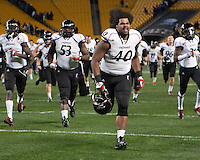 John Hughes (40) and other Bearcats run towards their fans after the win. Cincinnati Bearcats defeated the Pitt Panthers 26-23 at Heinz Field in Pittsburgh, Pennsylvania on November 5, 2011.