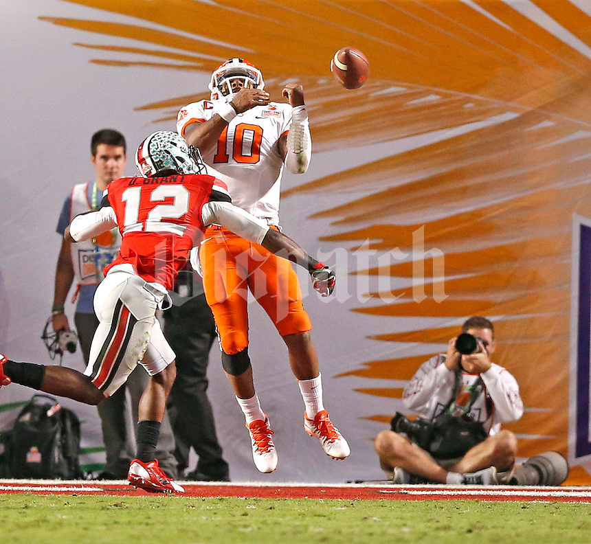 Ohio State Buckeyes cornerback Doran Grant (12) knocks the ball away from Clemson Tigers quarterback Tajh Boyd (10) in Clemson's 2 point conversion attempt in the fourth quarter at the 2014 Discover Orange Bowl at Sun Life Stadium in Miami Gardens, Florida on January 3, 2014. (Chris Russell/Dispatch Photo)