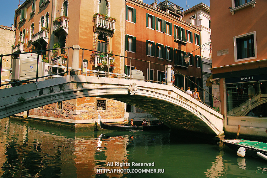 Long bridge over canal in Venice Italy with nobody.