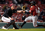 BOSTON, MA - APRIL 17: UMass catcher Connor Smith, left, prepares to tag out Harvard's Chad Minato at home plate in the fifth inning during the 30th Annual Baseball Beanpot Championship Game at Fenway Park in Boston, Massachusetts on April 17, 2019. Photo by Christopher Evans