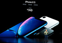 Phil Schiller, Apple's senior vice president of worldwide marketing, speaks about the new Apple iPhone XR at the Steve Jobs Theater during an event to announce new Apple products Wednesday, Sept. 12, 2018, in Cupertino, Calif. (AP Photo/Marcio Jose Sanchez)