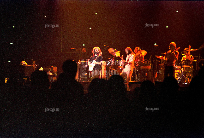 The Grateful Dead Performing Live in Concert at the Hartford Civic Center on 28 May 1977. Second Set. Original film scan from Kodak CG negative stock, pushed 2 stops, processing by Berkey K&L Lab NYC. Photography by James R Anderson.