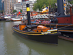 Historic ships and boats in the Haven museum in Leuvehaven dock, Rotterdam, Netherlands