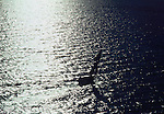 Early morning view of silhouetted fishing boat off the coast of Haiti. circa 1975