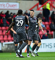 Lincoln City's Jason Shackell celebrates scoring the opening goal, with John Akinde, left<br /> <br /> Photographer Andrew Vaughan/CameraSport<br /> <br /> The EFL Sky Bet League Two - Swindon Town v Lincoln City - Saturday 12th January 2019 - County Ground - Swindon<br /> <br /> World Copyright &copy; 2019 CameraSport. All rights reserved. 43 Linden Ave. Countesthorpe. Leicester. England. LE8 5PG - Tel: +44 (0) 116 277 4147 - admin@camerasport.com - www.camerasport.com