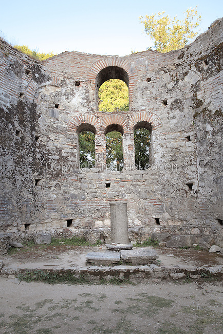 Apse of the Great Basilica, 6th century AD, seat of the bishop, Butrint, Chaonia, Albania. The Basilica originally had 3 aisles separated by colonnades of columns and capitals reused from earlier buildings and a floor paved with mosaic. Butrint was founded by the Greek Chaonian tribe and was a port throughout Hellenistic and Roman times, when it was known as Buthrotum. It was ruled by the Byzantines and the Venetians and finally abandoned in the Middle Ages. The ruins at Butrint were listed as a UNESCO World Heritage Site in 1992. Picture by Manuel Cohen