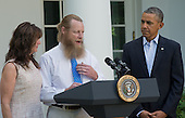 Bob Bergdahl (center) speaks about the release of his son United States Army Sergeant Bowe Bergdahl, as his wife Jani Bergdahl (left) and U.S. President Barack Obama (right) look on, following a statement by President Obama regarding the release of their son Sgt. Bowe Bergdahl by the Taliban, Saturday May 31, 2014, in the Rose Garden at the White House in Washington, D.C.<br /> Credit: John Harrington / Pool via CNP