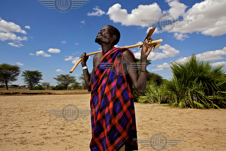Erot, the headman of a Turkana family, looks skywards near the village of Kache Imeri. Northern Kenya is in the midst of a severe drought, and in the absence of safe drinking water and food, pastoral tribes are extremely vulnerable to disease and famine.