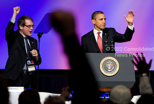 United States President Barack Obama delivers remarks at the United Auto Workers conference at the Marriott Wardman Park Hotel in Washington, D.C. on Tuesday, February 28, 2012. He is joined on stage by the UAW President Bob King, left..Credit: Kristoffer Tripplaar  / Pool via CNP